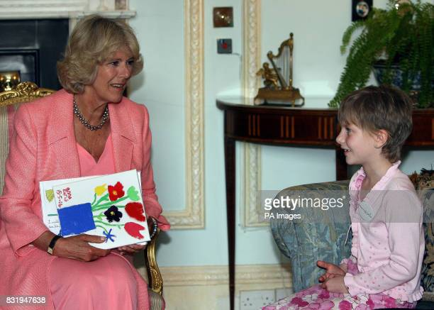 Anna Earls aged 8 from Dundonald in Belfast meeting the Duchess of Cornwall at Hillsborough Castle