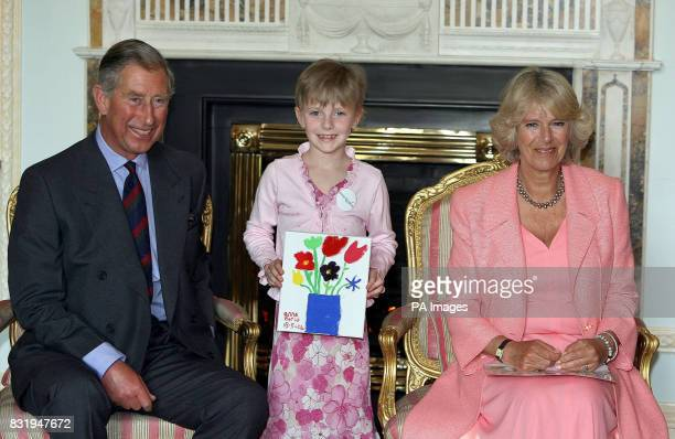 Anna Earls aged 8 from Dundonald in Belfast meeting the Prince of Wales and Duchess of Cornwall at Hillsborough Castle