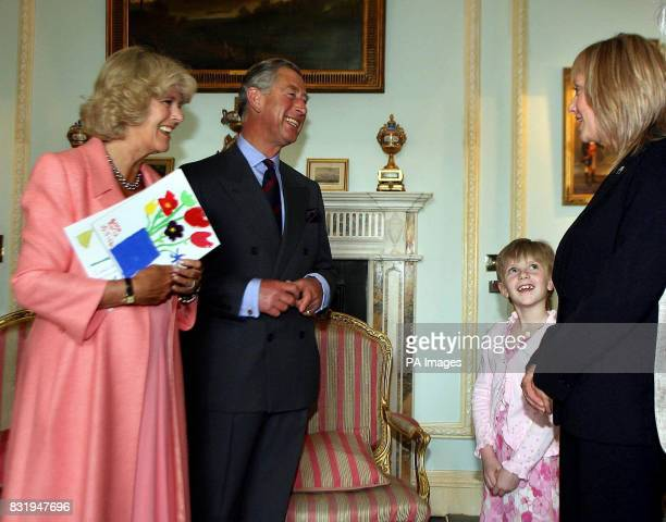 Anna Earls aged 8 from Dundonald in Belfast with her mum Alison meeting the Prince of Wales and Duchess of Cornwall at Hillsborough Castle
