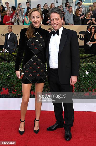 Anna Eberstein and actor Hugh Grant attend The 23rd Annual Screen Actors Guild Awards at The Shrine Auditorium on January 29 2017 in Los Angeles...