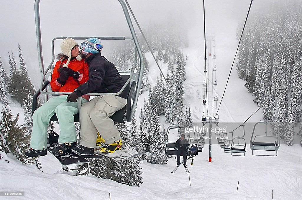Anna Ellis and Luke Fryer of Seattle smooch on Crystal Mountain's anachronism: a new double chair. And it's not an express chairlift. It's called Northway.