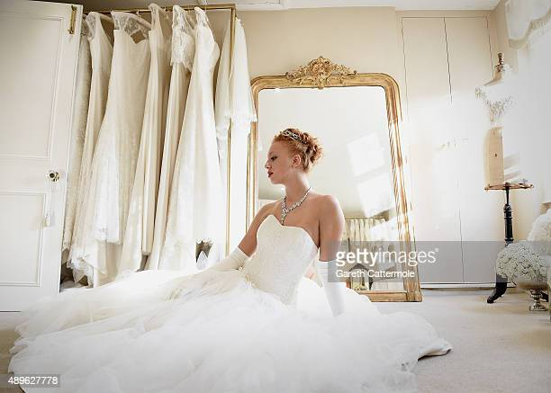 Anna Ermakova poses during a fitting in Emma Victoria Payne Bridalwear ahead of the Queen Charlotte Ball on September 11 2015 in London England Queen...