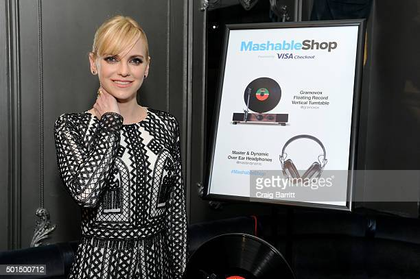 Anna Faris tries out the Gramovox Floating Record Verticle Turntable during the launch event for the firstever Mashable Shop powered by Visa Checkout...