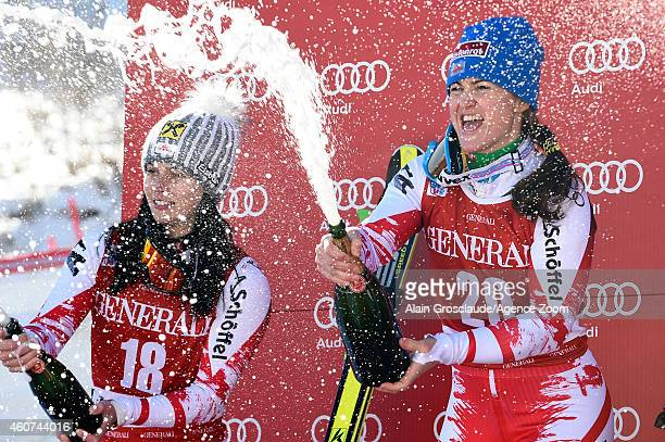 Anna Fenninger and Elisabeth Goerg celebrate on the podium during the Audi FIS Alpine Ski World Cup Women's SuperG on December 21 2014 in Val d'Isere...