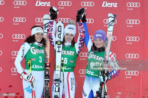 Anna Fenninger of Austria takes 1st place Federica Brignone of Italy takes 2nd place Tessa Worley of France takes 3rd place during the Audi FIS...