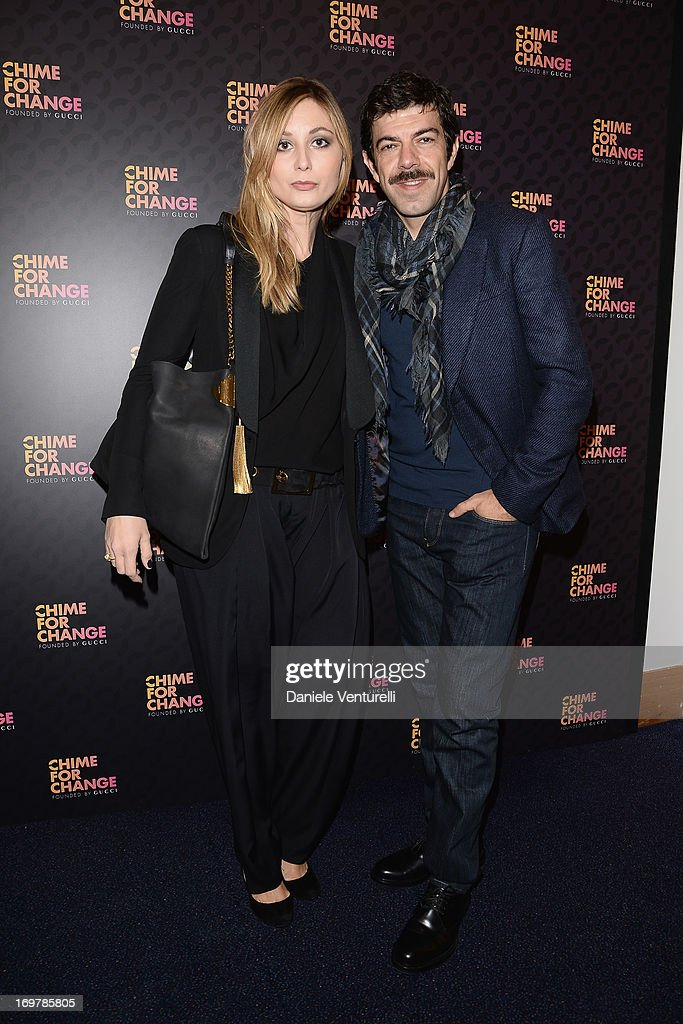 Anna Ferzetti and actor <a gi-track='captionPersonalityLinkClicked' href=/galleries/search?phrase=Pierfrancesco+Favino&family=editorial&specificpeople=676710 ng-click='$event.stopPropagation()'>Pierfrancesco Favino</a> arrive at the Royal Box photo wall ahead of the 'Chime For Change: The Sound Of Change Live' Concert at Twickenham Stadium on June 1, 2013 in London, England. Chime For Change is a global campaign for girls' and women's empowerment founded by Gucci with a founding committee comprised of Gucci Creative Director Frida Giannini, Salma Hayek Pinault and Beyonce Knowles-Carter.