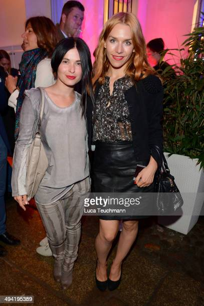 Anna Fischer and Julia Dietze attend Liebeskind Berlin Store Opening on May 28 2014 in Berlin Germany