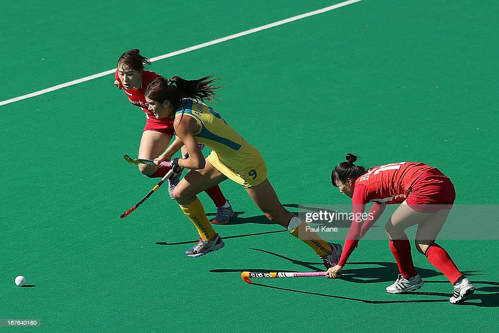 Anna Flanagan of Australiaruns onto the ball during the International Test match between the Australian Hockeyroos and Korea at Perth Hockey Stadium on April 27, 2013 in Perth, Australia.