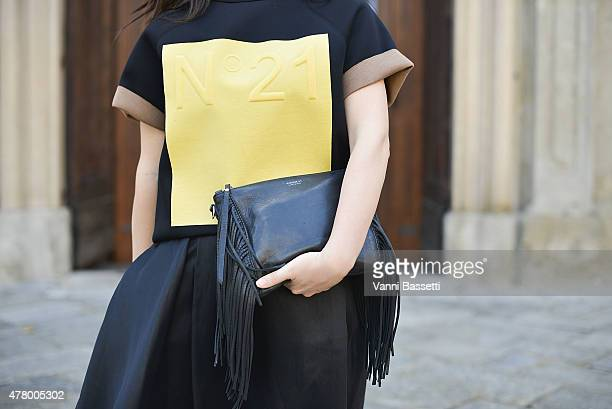 Anna Gaeta poses wearing a N21 top Cos skirt and Avenue 67 bag on June 21 2015 in Milan Italy