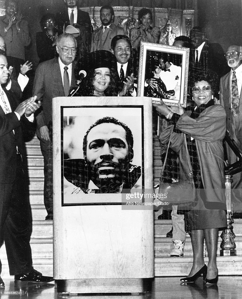 Anna Gaye presenting photo of Marvin Gaye to the Motown Museum in the lobby of the Fox Theatre Detroit Michigan April 3 1990