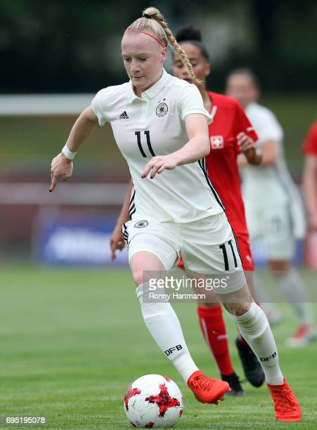 Anna Gerhardt of Germany runs with the ball during the U19 women's elite round match between Germany and Switzerland at Friedensstadion on June 9...