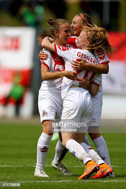 Anna Gerhardt of Koeln celebrates the third goal qith Yvonne Zielinski and AnnaSophie Fliege of Koeln during the Women's 2nd Bundesliga match between...
