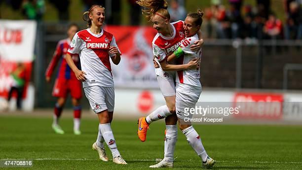 Anna Gerhardt of Koeln celebrates the third goal with AnnaSophie Fliege of Koeln and Yvonne Zielinski of Koeln during the Women's 2nd Bundesliga...