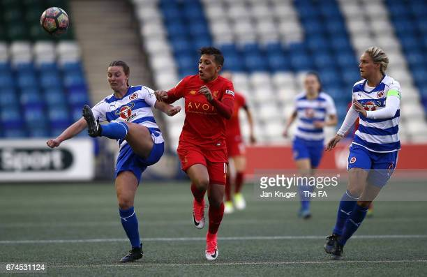 Anna Green of Reading FC Women clears the ball from Shanice van de Sanden of Liverpool Ladies during the WSL 1 match between Liverpool Ladies and...