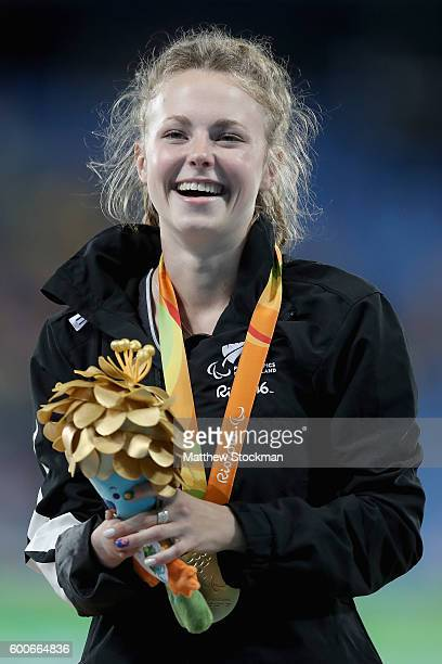 Anna Grimaldi of New Zealand celebrates on the medals podium after winning the women's long jump T47 on day 1 of the Rio 2016 Paralympic Games at on...