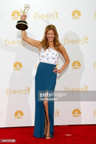 Anna Gunn poses in the press room with her award for Outstanding Supporting Actress in a Drama Series for 'Breaking Bad' at Nokia Theatre LA Live on...