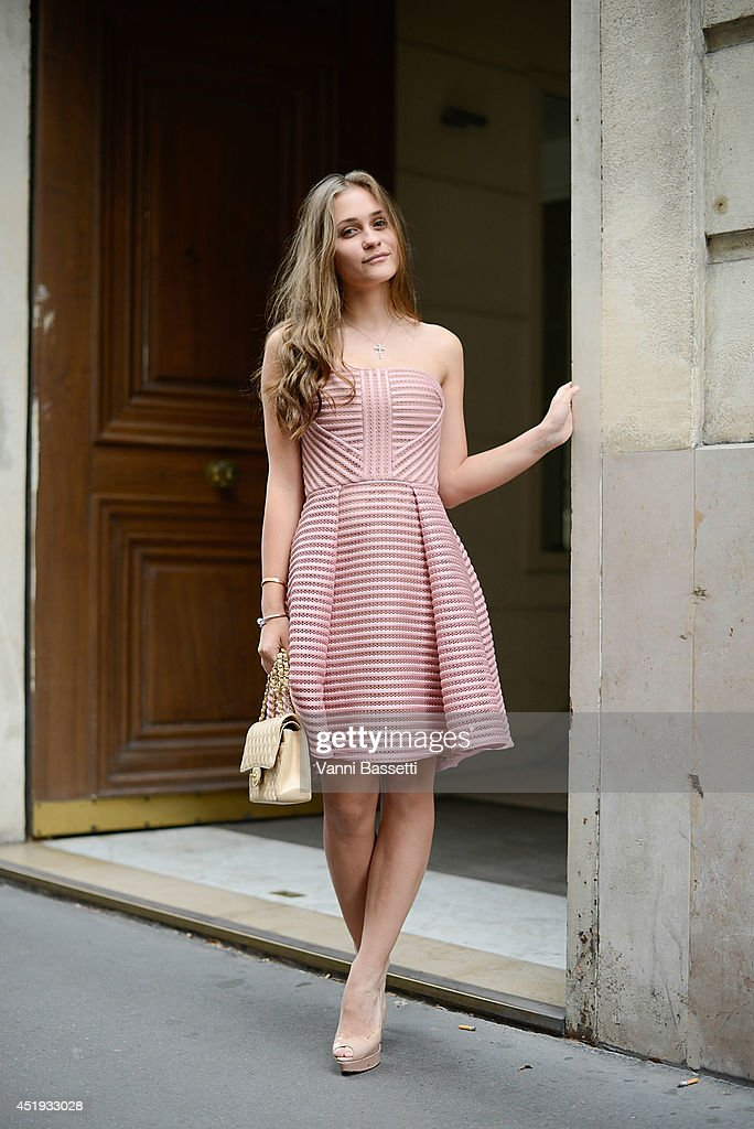 Anna Guzenko poses wearing an Elie Saab dress and a Chanel bag before Elie Saab show on July 9, 2014 in Paris, France.