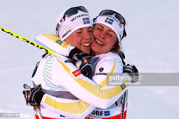 Anna Haag of Sweden celebrates with her team mate Charlotte Kalla winning the women's pursuit 5 km classic and 5 km free event for the FIS Cross...
