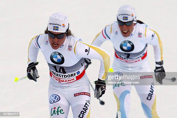 Anna Haag of Sweden wins the women's pursuit 5 km classic and 5 km free event for the FIS Cross Country World Cup Tour de Ski ahead of her team mate...