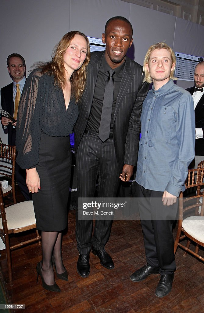(L to R) Anna Haber, Usain Bolt and Dominic Jones attend the Zeitz Foundation and ZSL Gala at London Zoo on November 22, 2012 in London, England.