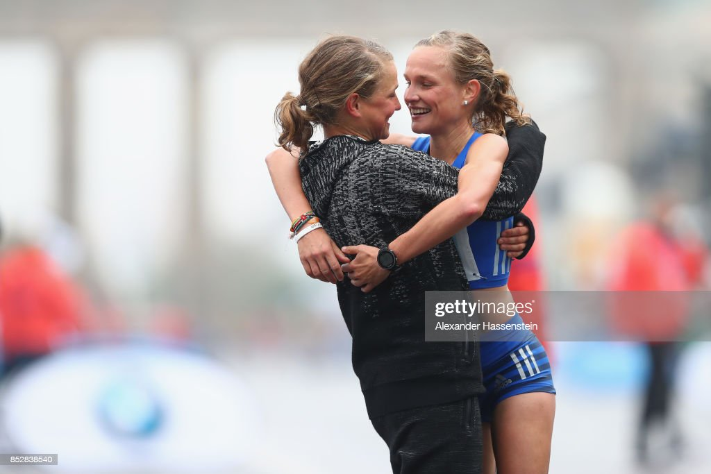 Anna Hahner (R) of Germany celebrates with her sister Lisa Hahner after the finish line of the BMW Berlin Marathon 2017 on September 24, 2017 in Berlin, Germany.