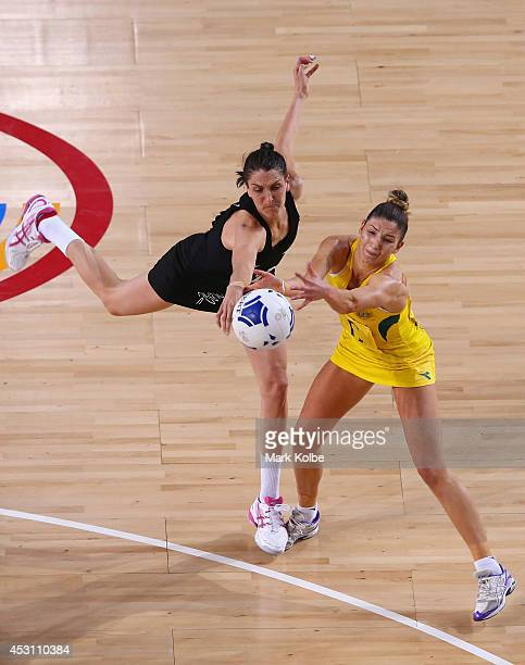 Anna Harrison of New Zealand and Julie Corletto of Australia compete for the ball during the gold medal netball match between Australia and New...