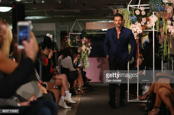 Anna Heinrich looks on as Tim Robards showcases designs during the Myer Fashion Runway show on March 16 2017 in Sydney Australia