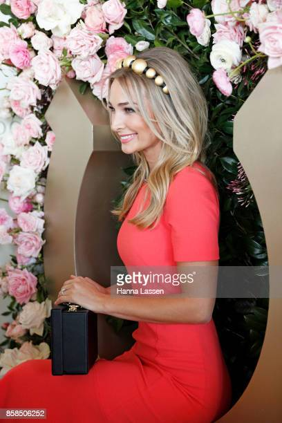 Anna Heinrich wearing Viktoria Novak headpiece Rebecca Vallance dress and The Daily Edited clutch at Moet Chandon Spring Champion Stakes Day at Royal...