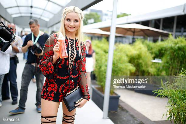 Anna Hiltrop with a bottle of Quickcap during the MercedesBenz Fashion Week Berlin Spring/Summer 2017 at Erika Hess Eisstadion on June 28 2016 in...