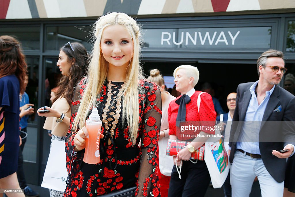 Anna Hiltrop with a bottle of Quickcap during the Mercedes-Benz Fashion Week Berlin Spring/Summer 2017 at Erika Hess Eisstadion on June 28, 2016 in Berlin, Germany.