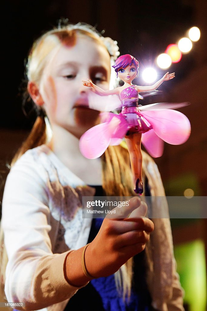 Anna Hooper, (10), controls a Flying Fairy by Flutterbye at a media event at St Mary's Church in Marylebone on November 6, 2013 in London, England. The Toy Retailers Association's Dream Toys chart, is an independent list of the predicted Christmas top 12 best-selling gifts for children