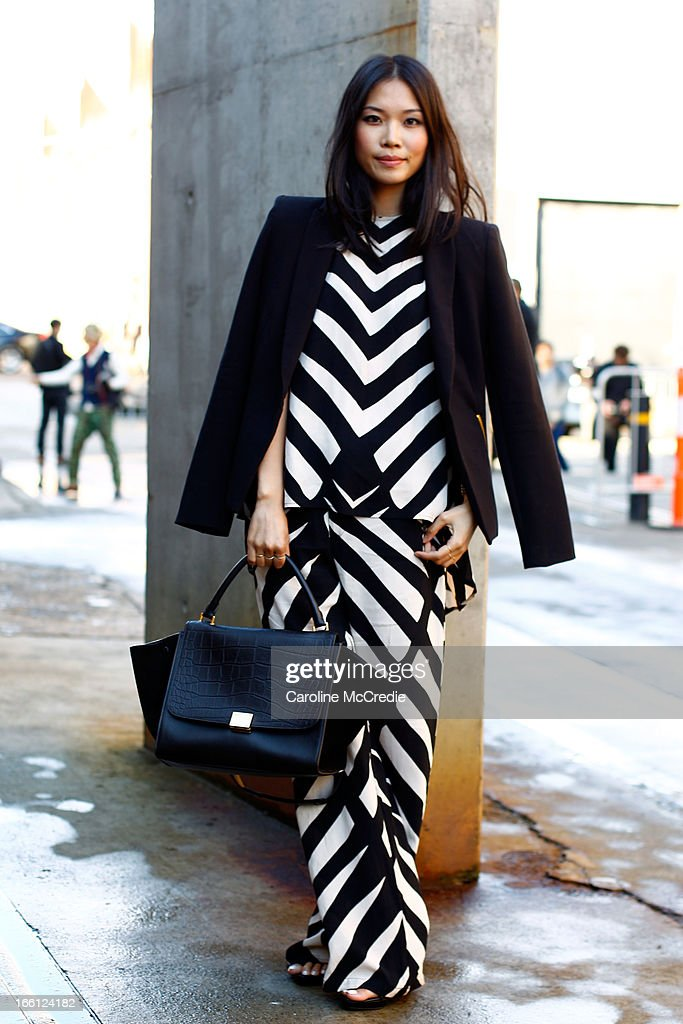 Anna Hua wears a top by Mister Zimmi, shoes and blazer by Zara and carries a bag by Celine at Mercedes-Benz Fashion Week Australia Spring/Summer 2013/14 at Carriageworks on April 9, 2013 in Sydney, Australia.