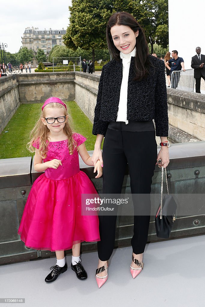Anna Jukova and her daughter attend the Christian Dior show as part of Paris Fashion Week Haute-Couture Fall/Winter 2013-2014 at on July 1, 2013 in Paris, France.