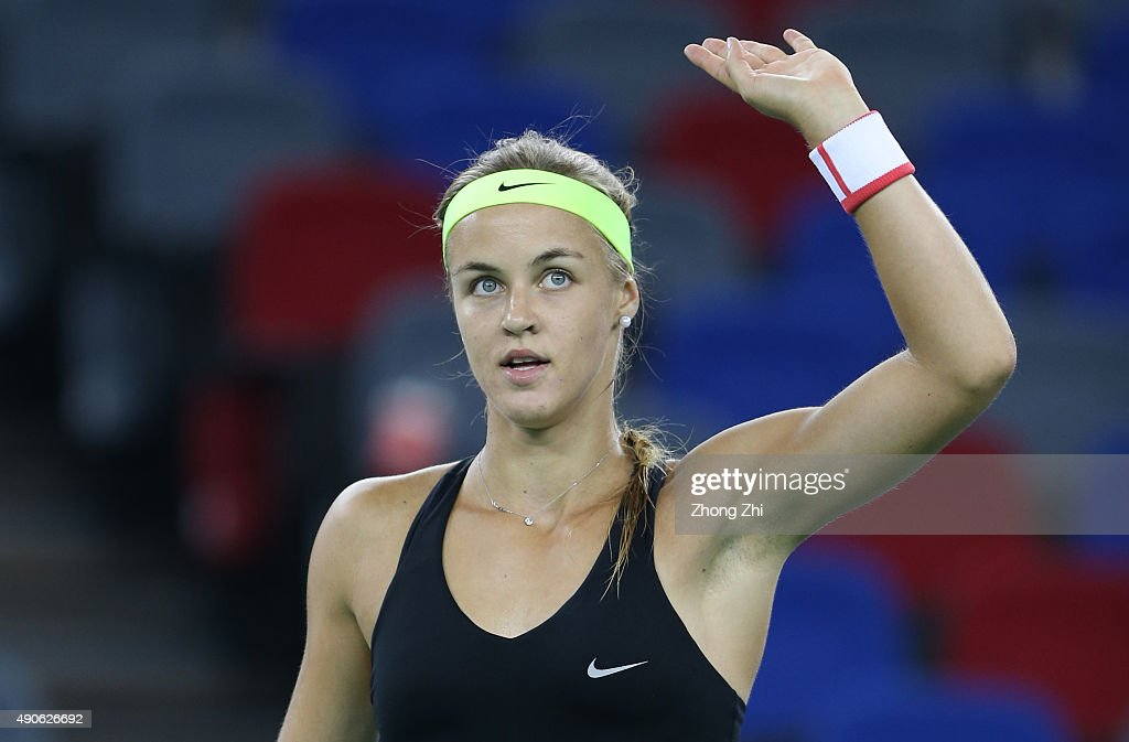 Anna Karolina Schmiedlova of Slovakia reacts after winning the match against Kristina Mladenovic of France on Day 4 of 2015 Dongfeng Motor Wuhan Open at Optics Valley International Tennis Center on September 30, 2015 in Wuhan, China.