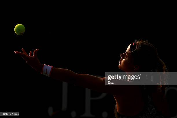 Anna Karolina Schmiedlova of Slovakia serves against Julia Goerges of Germany during their Women's Singles First Round match on Day Two of the 2015...
