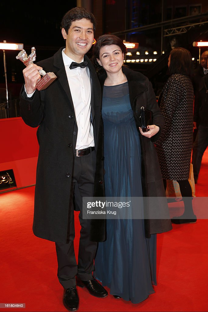 Anna Katchko ( R ) with Aziz Zhambakiyev who holds the Silver Bear for an outstanding artistic achievement at the Closing Ceremony Red Carpet Arrivals - BMW At The 63rd Berlinale International Film Festival at Berlinale-Palast on February 16, 2013 in Berlin, Germany.