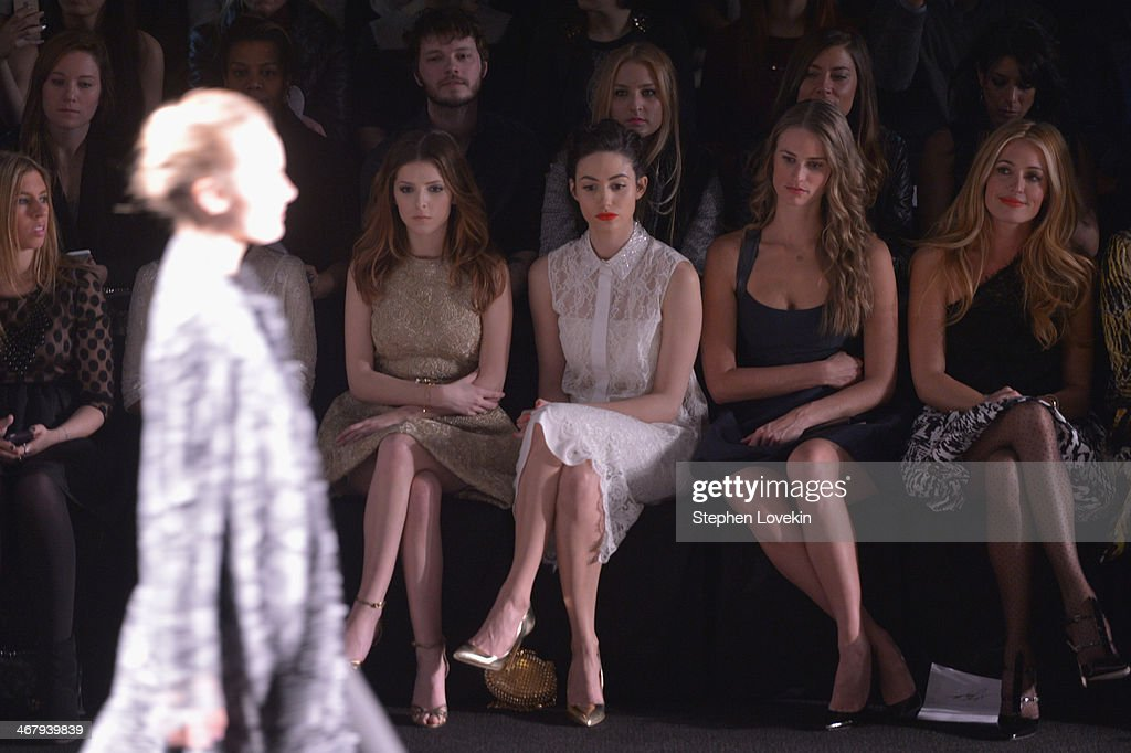 <a gi-track='captionPersonalityLinkClicked' href=/galleries/search?phrase=Anna+Kendrick&family=editorial&specificpeople=3244893 ng-click='$event.stopPropagation()'>Anna Kendrick</a>, <a gi-track='captionPersonalityLinkClicked' href=/galleries/search?phrase=Emmy+Rossum&family=editorial&specificpeople=202563 ng-click='$event.stopPropagation()'>Emmy Rossum</a>, <a gi-track='captionPersonalityLinkClicked' href=/galleries/search?phrase=Julie+Henderson&family=editorial&specificpeople=4154524 ng-click='$event.stopPropagation()'>Julie Henderson</a>, <a gi-track='captionPersonalityLinkClicked' href=/galleries/search?phrase=Cat+Deeley&family=editorial&specificpeople=202554 ng-click='$event.stopPropagation()'>Cat Deeley</a> attend the Monique Lhuillier fashion show during Mercedes-Benz Fashion Week Fall 2014 at The Theatre at Lincoln Center on February 8, 2014 in New York City.