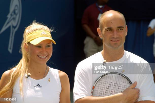 Anna Kournikova and Andre Agassi during 2003 US Open Arthur Ashe Kids Day at USTA National Tennis Center in Queens New York United States