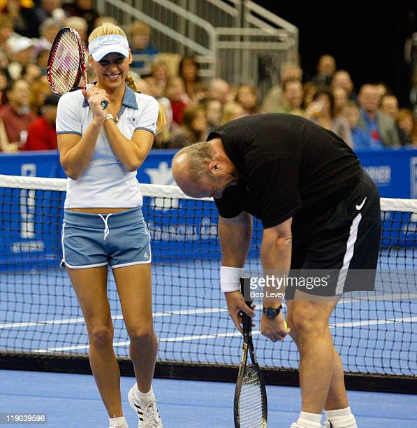 Anna Kournikova and Dr Phil during their mixed doubles match at the Serving for Tsunami Relief tennis exhibition benefiting the the BushClinton...