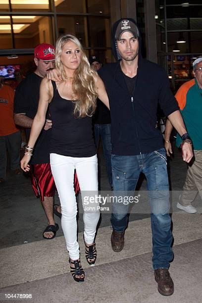 Anna Kournikova and Enrique Iglesias leave the Orange Carpet for the Miami Dolphins versus New York Jets game at Sun Life Stadium on September 26...