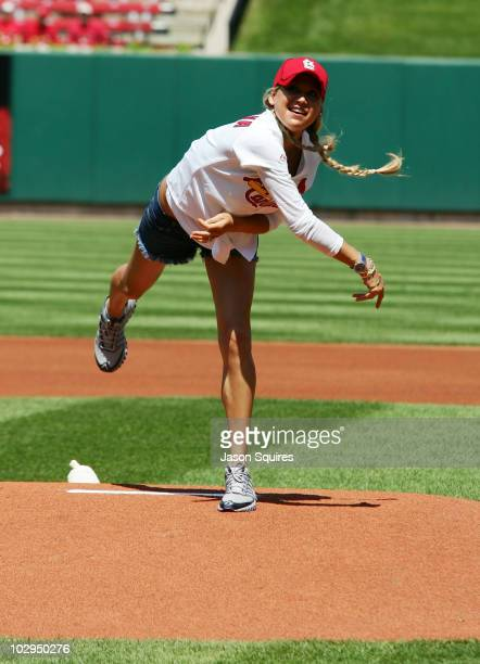 Anna Kournikova throws the first pitch at the Los Angles Dodgers vs St Louis Caridnals game at Busch Stadium on July 17 2010 in St Louis Missouri