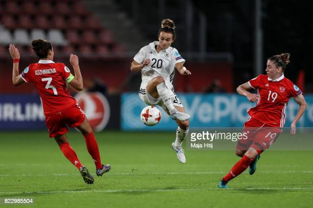 Anna Kozhnikova of Russia Lina Magull of Germany and Ekaterina Morozova of Russia battle for the ball during the Group B match between Russia and...
