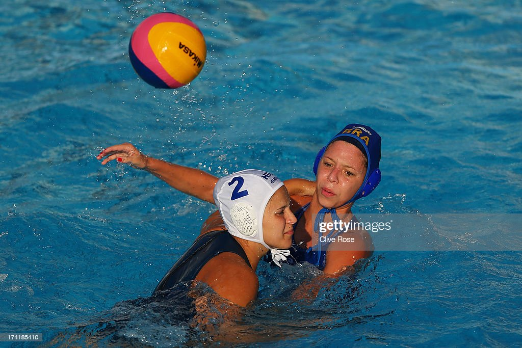 Anna Krisztina Illes of Hungary in action with Izabella Chiappini of Brazil during the Women's Water Polo first preliminary round match between Hungary and Brazil during Day Two of the 15th FINA World Championships at Piscines Bernat Picornell on July 21, 2013 in Barcelona, Spain.