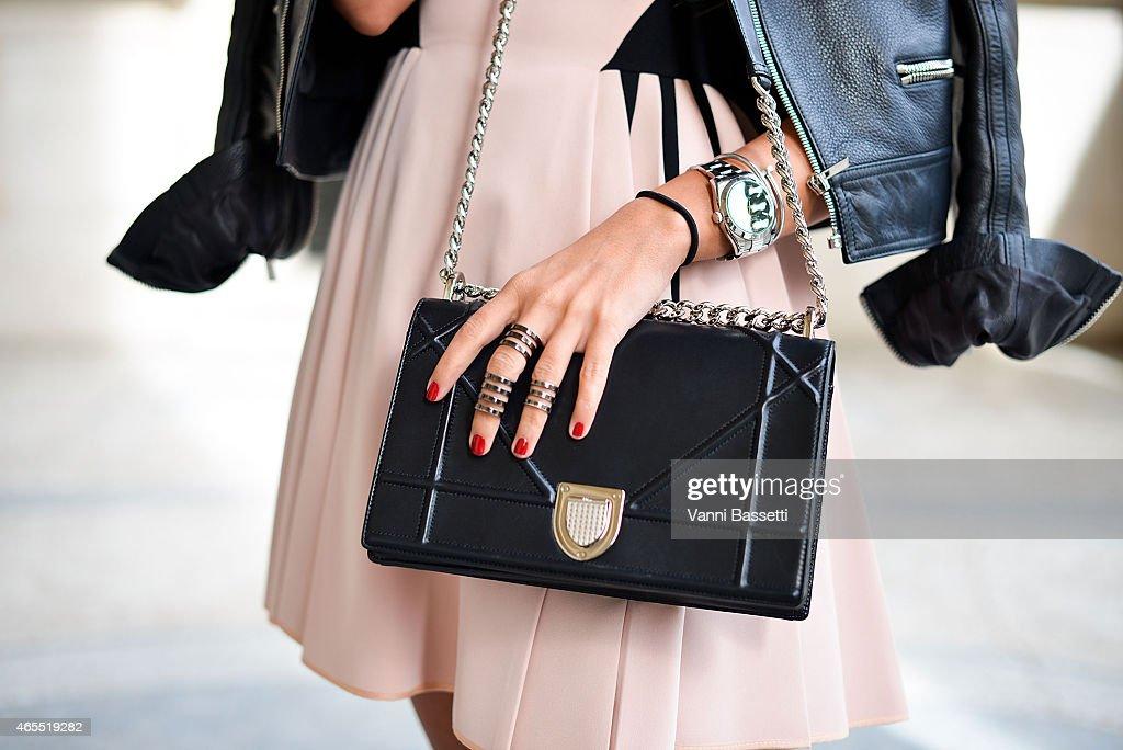 Anna Kuiria poses wearing a Balenciaga jacket David Koma dress and Dior bag on Day 5 of Paris Fashion Week Womenswear FW15 on March 7 2015 in Paris...