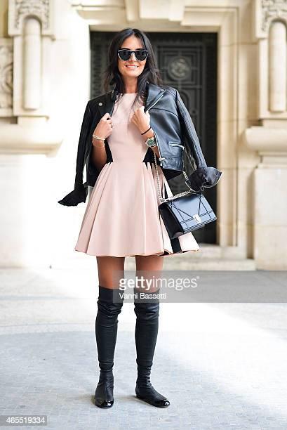 Anna Kuiria poses wearing a Balenciaga jacket David Koma dress Dior bag and Chanel shoes on Day 5 of Paris Fashion Week Womenswear FW15 on March 7...