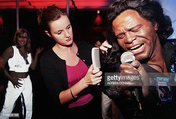 Anna Lane a hair and colour stylist gives James Brown a quick makeover at Madame Tussauds Rock Circus in London 28 September 1999 The waxwork models...