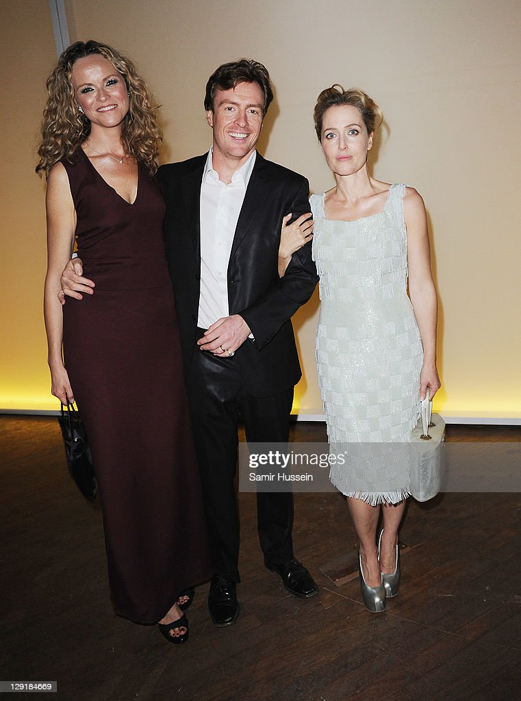 Anna Louise Plowman, <a gi-track='captionPersonalityLinkClicked' href=/galleries/search?phrase=Toby+Stephens&family=editorial&specificpeople=806801 ng-click='$event.stopPropagation()'>Toby Stephens</a> and <a gi-track='captionPersonalityLinkClicked' href=/galleries/search?phrase=Gillian+Anderson&family=editorial&specificpeople=202894 ng-click='$event.stopPropagation()'>Gillian Anderson</a> poses at the Calvin Klein Collection Hosts Dinner to Celebrate The New Home of London's Design Museum at The Design Museum on October 13, 2011 in London, England.