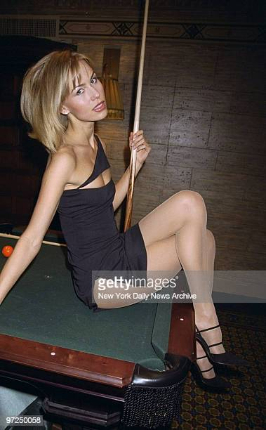 Anna Malova Miss Russia 1998 poses on a pool table at The Campbell Apartment restaurant in Grand Central Station She makes her motion picture debut...