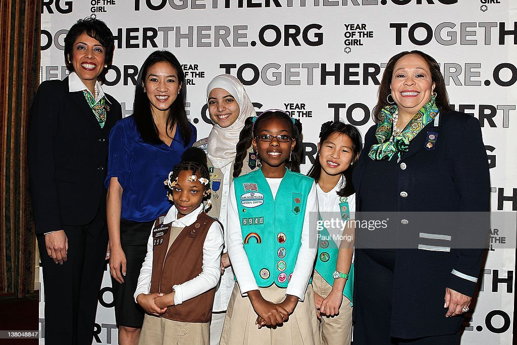 Anna Maria Chavez, Chief Executive Officer of Girl Scouts of the USA, Olympic Figure Skater <a gi-track='captionPersonalityLinkClicked' href=/galleries/search?phrase=Michelle+Kwan&family=editorial&specificpeople=201485 ng-click='$event.stopPropagation()'>Michelle Kwan</a>, and Connie L. Lindsey, National President, Girl Scouts of the USA, pose for a photo with area Girl Scouts at Girl Scouts At 100: The Launch of ToGetHerThere at Capitol Hill Cannon House Office Bldg, Caucus Room on February 1, 2012 in Washington, DC.