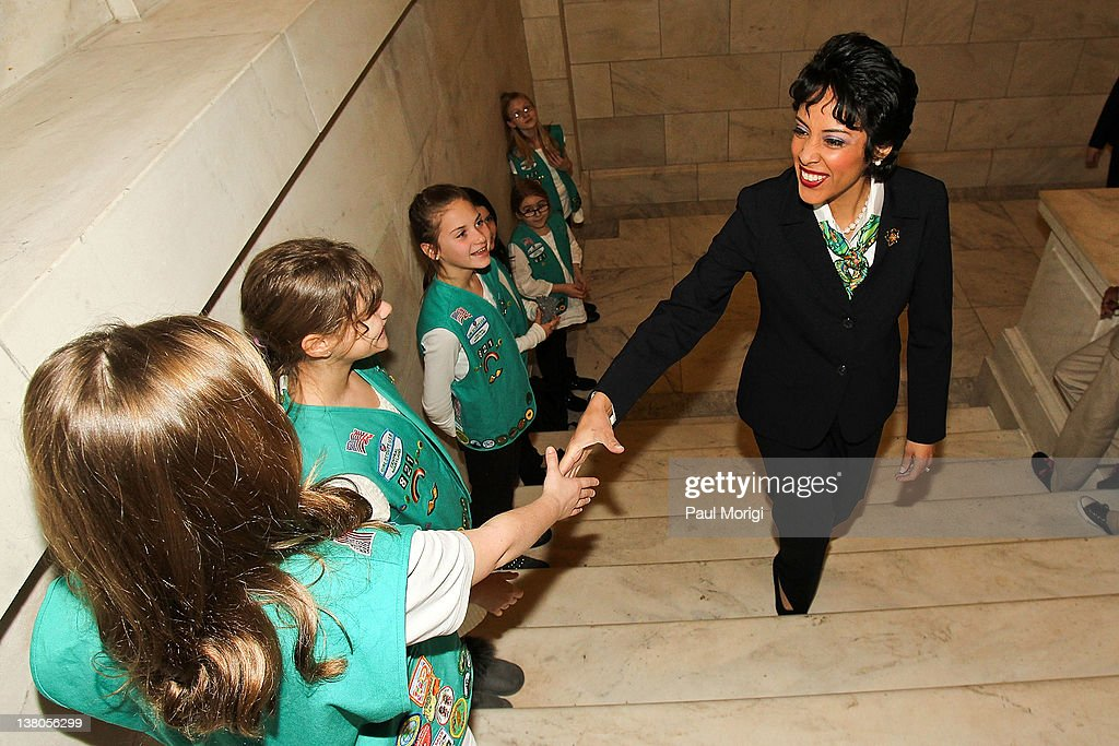 Anna Maria Chavez, Chief Executive Officer of Girl Scouts of the USA, is greeted by area Girl Scouts as she arrives at Girl Scouts At 100: The Launch of ToGetHerThere at Capitol Hill Cannon House Office Bldg, Caucus Room on February 1, 2012 in Washington, DC.
